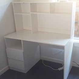Desk with drawers and hutch