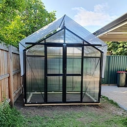 Glasshouse with shade cover